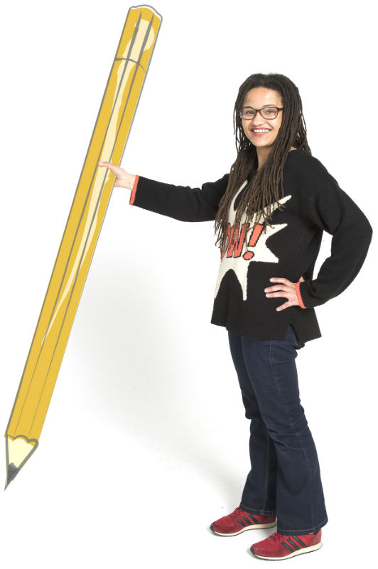 Woman holding giant pencil